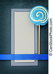 Blank banner with lollipop on blue background
