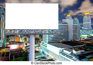Blank billboard for advertisement in city downtown at night