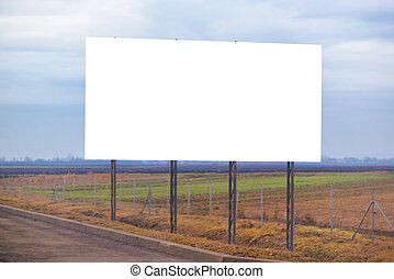 Blank billboard hoarding by the roadway, copy space for graphic design mock up.