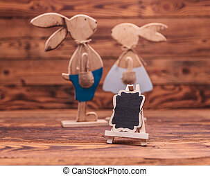 blank billboard in front of a wooden easter bunnies