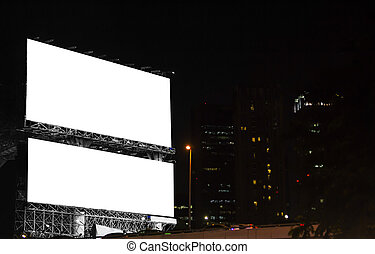 Blank billboard in the city at night