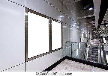 Blank billboard in train station