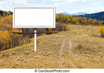 Blank Billboard Sign Along Dirt Trail in Mountains