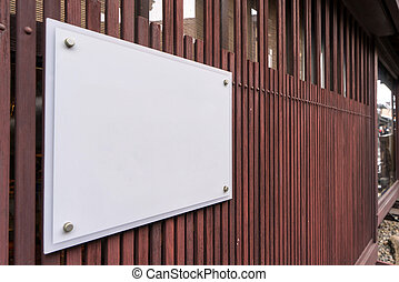 blank billboards attached to a buildings exterior wall