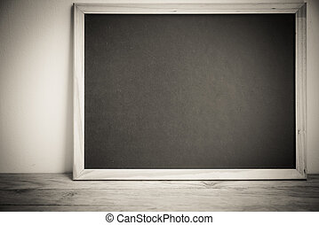 Blank black board on the wall in monochrome style