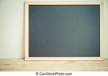 Blank black board on the wall