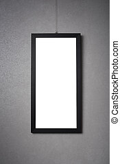 blank black frame on a dark wall