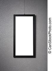 blank black frame on a dark wall