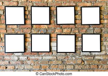 Blank black frames old on old brick wall