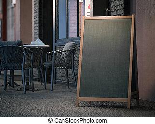 Blank black menu board on sidewalk. 3d rendering