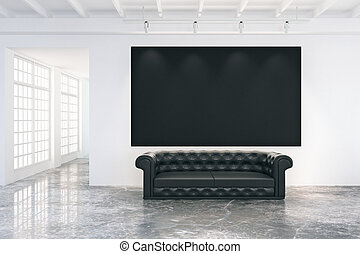 Blank black poster on white wall in loft room with black leather sofa and big windows, mock up