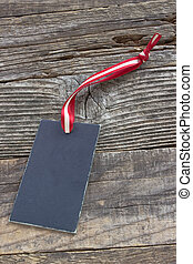 Blank black price tag on wooden background