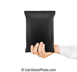 Blank black snack bag mock up hold in hand isolated.