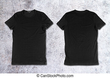 Blank black t-shirts on a concrete surface