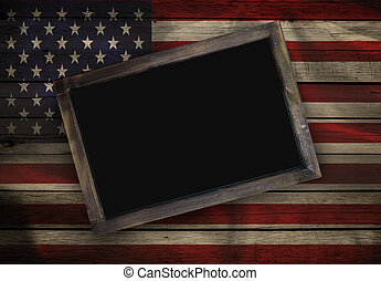 Blank blackboard on American flag wood background