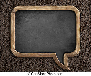 Blank blackboard on soil for sowing advice or text message