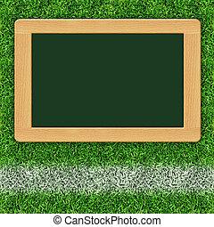 blank blackboard on the grass