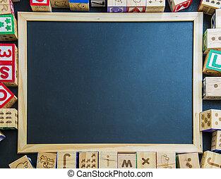 Blank blackboard on wooden block