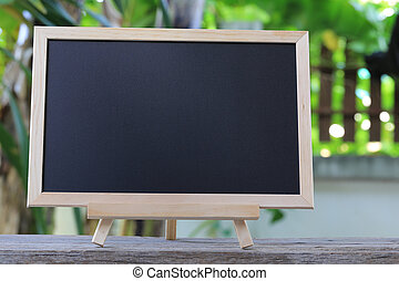 blank blackboard place on a wooden floor. - blank blackboard...