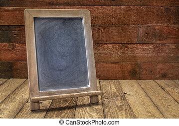 blank  blackboard sign on rustic wood
