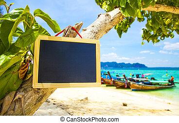 Blank blackboard sign on tropical beach
