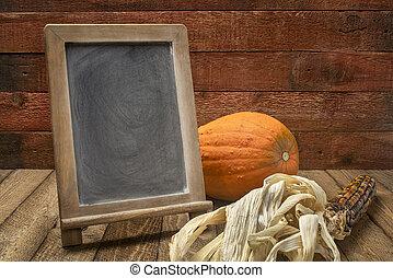 blank  blackboard sign with pumpkin and corn