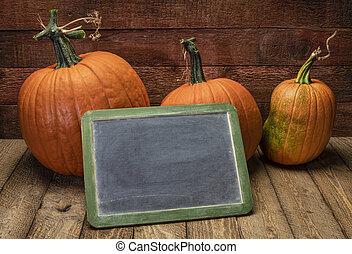 blank  blackboard sign with pumpkin