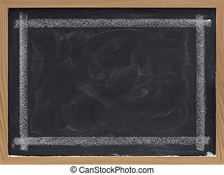 blank blackboard with eraser smudges and thick white chalk line frame