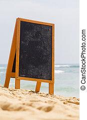 Blank board on the beach