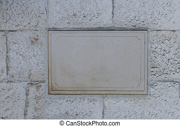 Blank board on the stone wall