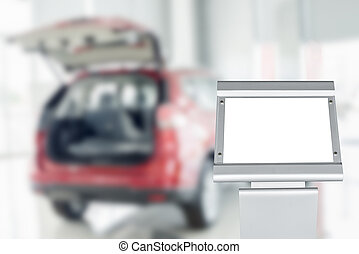 Blank board with blurry car in auto show or salon