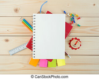 Blank book and colorful stationery on the wooden table