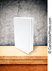 Blank book with white covers at office table