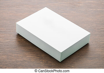Blank box mock up on wooden background