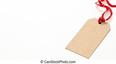 Blank brown cardboard price tag isolated on white background.