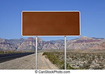 Blank Brown Highway Sign in the Mojave Desert - Blank brown...