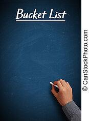 Blue Bucket List chalkboard with businessman hand aside.