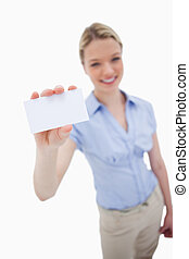 Blank business card being held by smiling woman