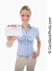 Blank business card being held by woman