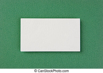 blank business card on a green background