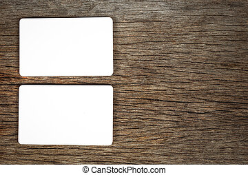 Blank business card on wood grain background