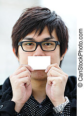 Blank business card with asian man