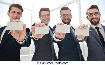 blank business cards in the hands of the business team