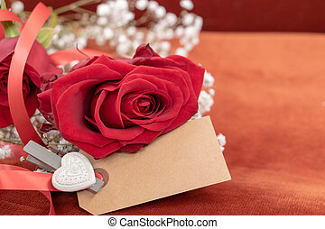 Blank card and red rose for a message full of love