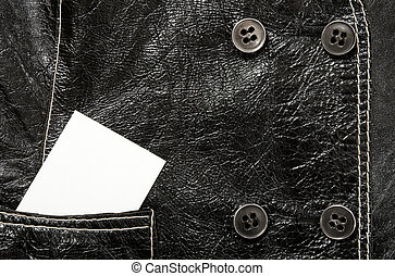 Blank card in a pocket of leather jacket
