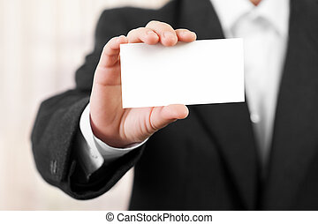 Blank card in businessmen hand