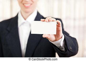 Blank card in women hand
