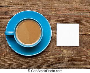 blank card on coffee cup