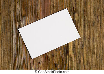 Blank card over wood
