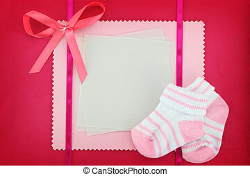 Blank card with baby socks on blue background